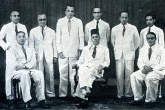 CMSF Committee of Management 1954. Seated (L-R): A.M.A. Azeez (Chairman), M.M. Ebrahim (President BoT), & M.H.A. Aziz (Secretary). Standing (L-R): M.H.S. Marikar, Dr. A.R.M. Waffarn, M. Rafeek, M.H.M. Naina Marikar, A.J.M. Jameel & M.U.M. Saleem.